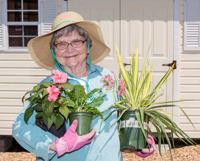A resident enjoys her gardening time