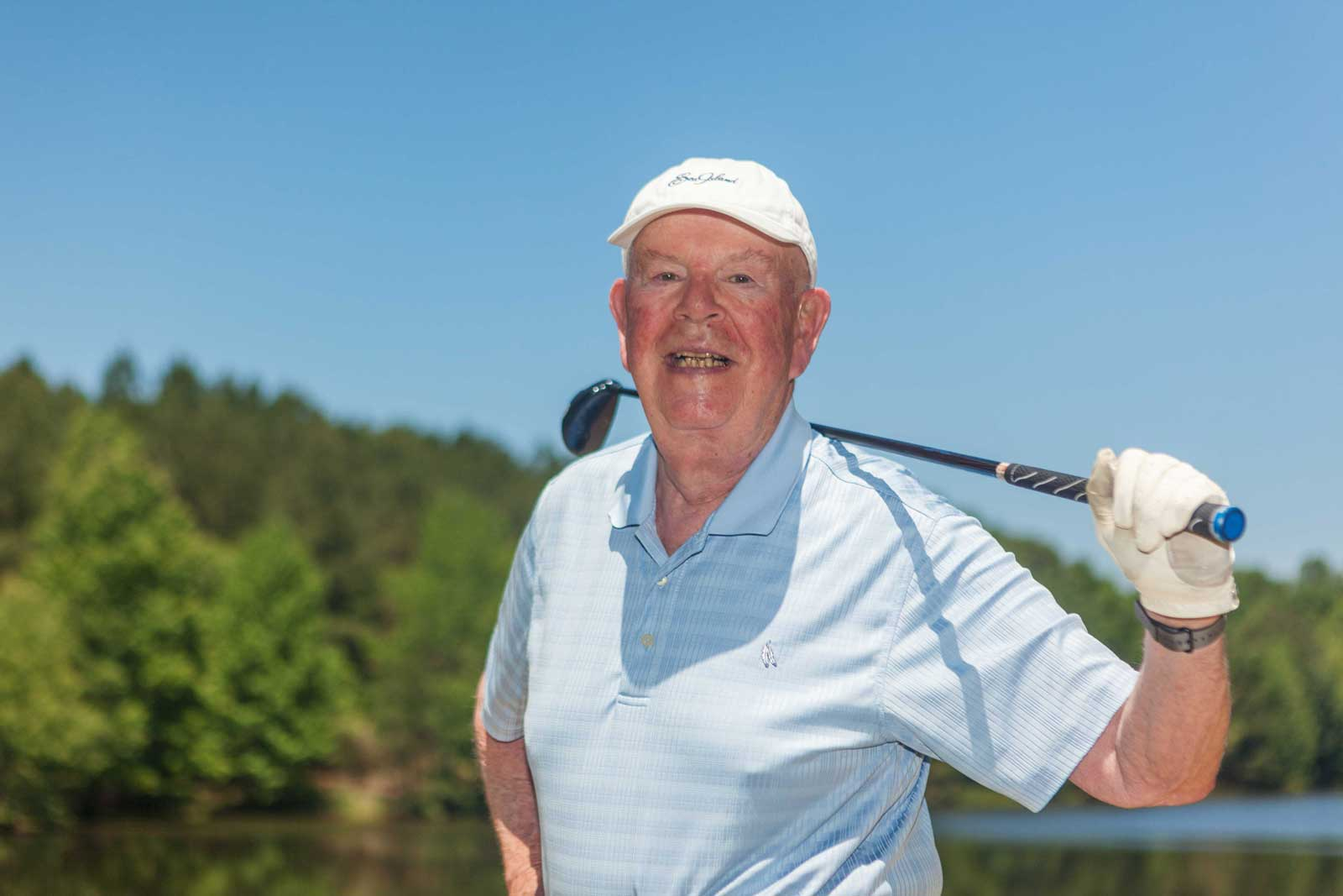 A resident pauses during an enjoyable round of golf